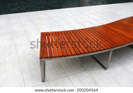 wooden bench in the public park  - stock photo