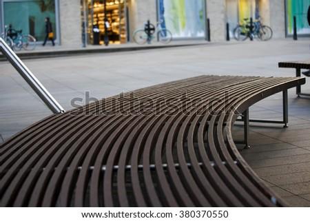 Wooden bench near market. Selective focus - stock photo