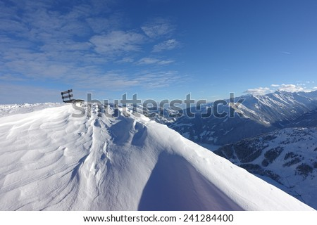 Wooden bench with view on the mountain summit - stock photo