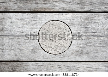Wooden bench with wooden circle for background - stock photo