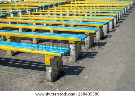 wooden benches in a city park - stock photo