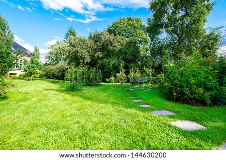 Wooden benches in the garden - stock photo