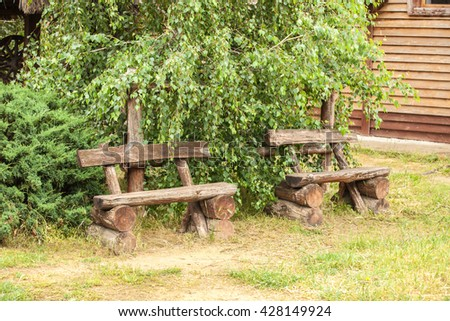 wooden benches in the park - stock photo