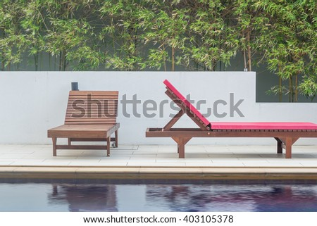 Wooden benchs beside the swimming pool