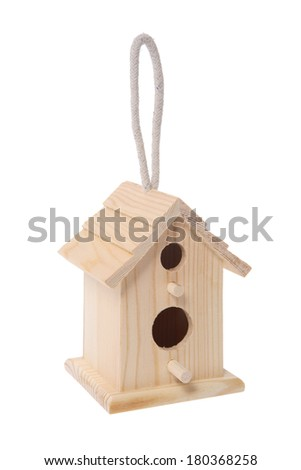 Wooden birdhouse with rope to hang on white background - stock photo