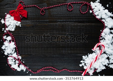 Wooden black background with red New Year's decoration