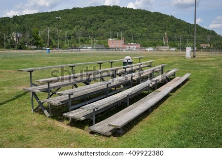 Wooden bleacher in a sunny day - stock photo