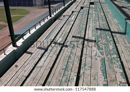 Wooden bleachers at a baseball field. - stock photo