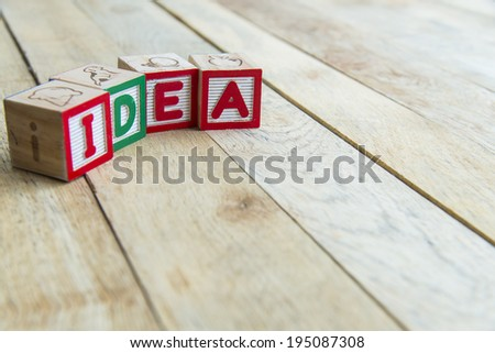 Wooden blocks are Idea word on wooden floor2 - stock photo
