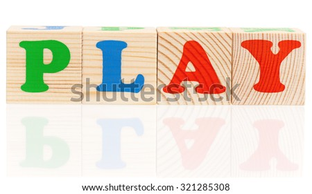 Wooden blocks arranged in the word PLAY - isolated on white background - stock photo