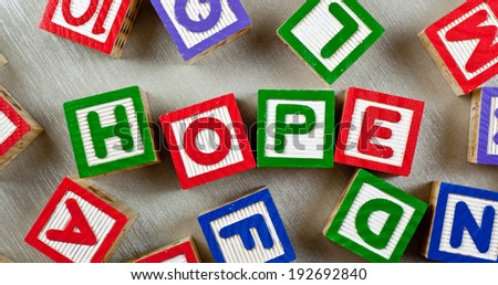 Wooden blocks forming the word HOPE in the center  - stock photo