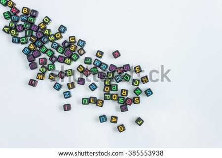 wooden blocks forming the word learn in the center on white background