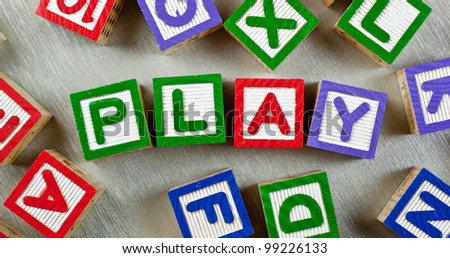 Wooden blocks forming the word PLAY in the center