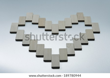 Wooden blocks laid in heart shape - stock photo