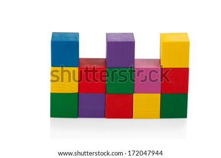 Wooden blocks, pyramid of colorful cubes, childrens toy isolated on white background - stock photo