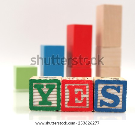 wooden blocks spelling the word yes