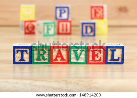 Wooden blocks with letters. Children educational toy concept - travel with kids. - stock photo