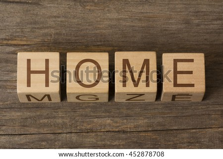 Wooden blocks with letters spelling Home - stock photo