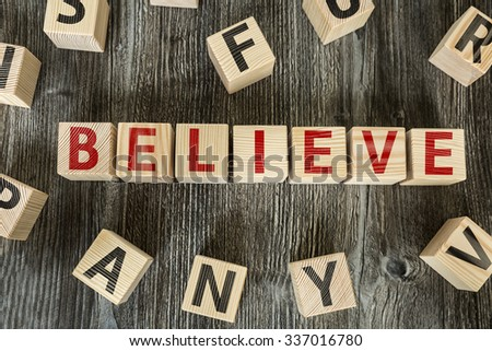 Wooden Blocks with the text: Believe - stock photo