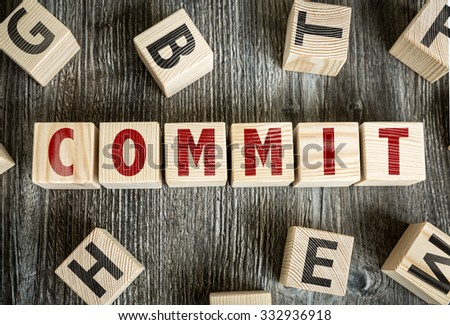 Wooden Blocks with the text: Commit - stock photo