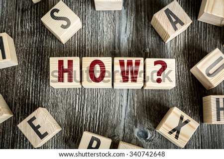 Wooden Blocks with the text: How - stock photo