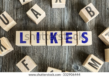 Wooden Blocks with the text: Likes - stock photo