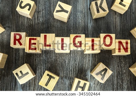 Wooden Blocks with the text: Religion - stock photo
