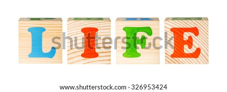 wooden blocks with the word life isolated on a white background