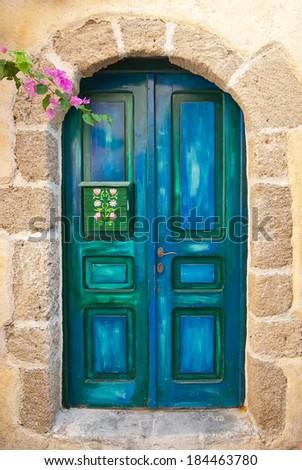 Wooden Blue Old Door of Greek Island - stock photo
