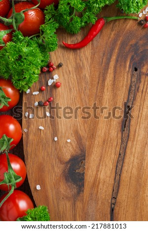 wooden board background, fresh tomatoes, spices and herbs, vertical, top view