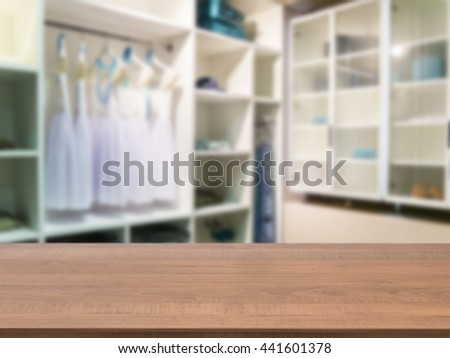Wooden board empty table in front of blurred background. Perspective dark wood over blur in closet room for background uses. Mock up for display or montage your products - stock photo