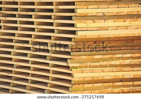 Wooden board for terrace, stacked at construction site - stock photo