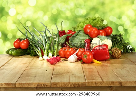 wooden board fruits of red and green colors and garden of green  - stock photo