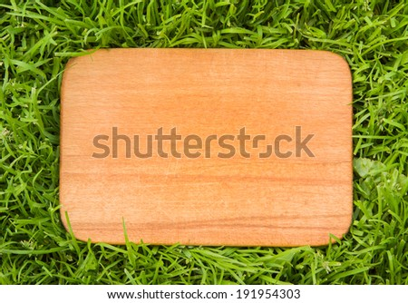 wooden board on green grass