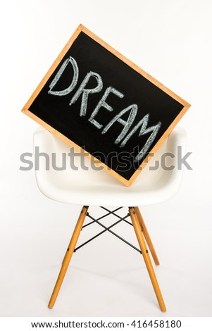 Wooden board on white chair isolated on white. Dream concept - stock photo