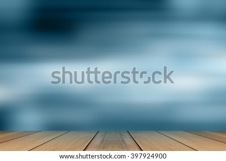 Wooden board with Blue bokeh. Blurred light on blue background. - stock photo