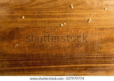 Wooden board with chopped garlic remains - stock photo