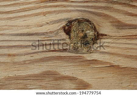 wooden board with knots and cracks background