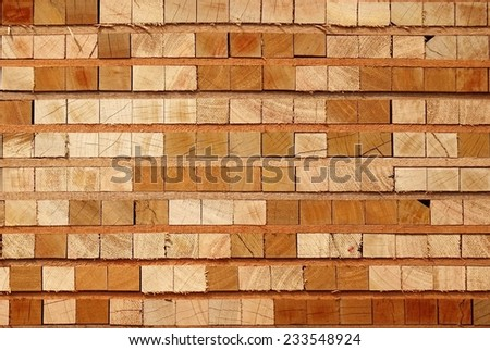 Wooden boards and beams stacked at a lumber yard  - stock photo