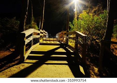 wooden boardwalk by night, Sardinia - stock photo