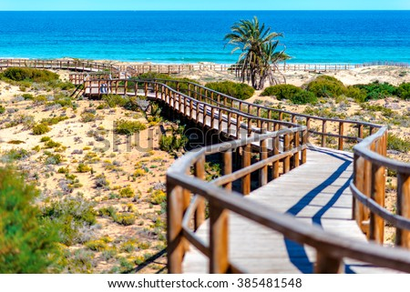 Wooden boardwalk on the Los Arenales del Sol beach. Alicante province, Costa Blanca. Spain