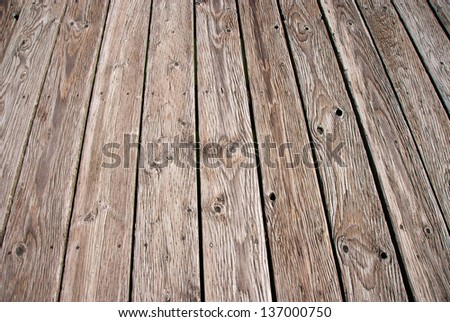 Wooden boardwalk. Weathered and rough textured - stock photo