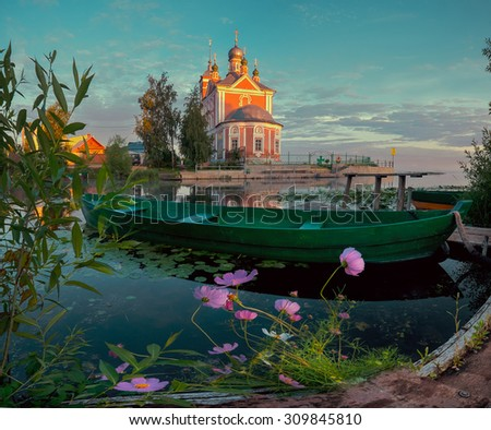 Wooden boat and church in small town Pereslavl Zalessky in Russia. - stock photo