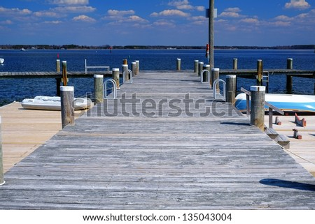 Wooden boat dock on a gorgeous day on the Chesapeake Bay - stock photo