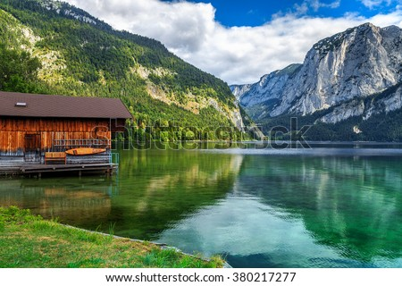Wooden boat dock with high rocky mountains in background,Altaussee,Salzkammergut,Austria,Europe