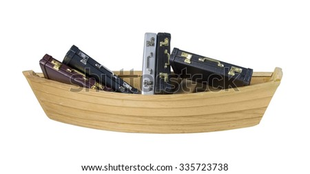 Wooden boat filled with Leather briefcase used to carry items to the office - path included - stock photo