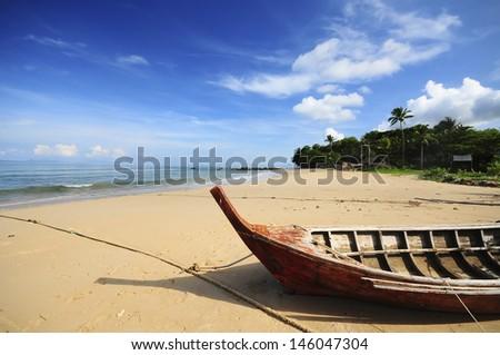 Wooden boat on a beautiful beach_Koh Lanta Thailand - stock photo