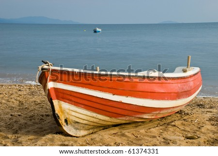 Wooden boat on beach - stock photo