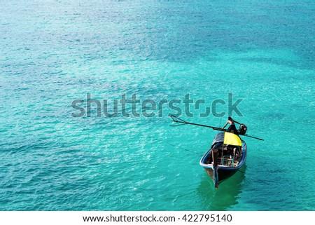 Wooden boat on beautiful ocean in Lipe island, Thailand - stock photo