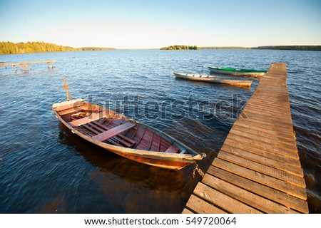 wooden boat on the lake in the evening